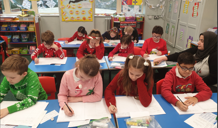 Christmas Jumper Day – The children working exceptionally hard in English.