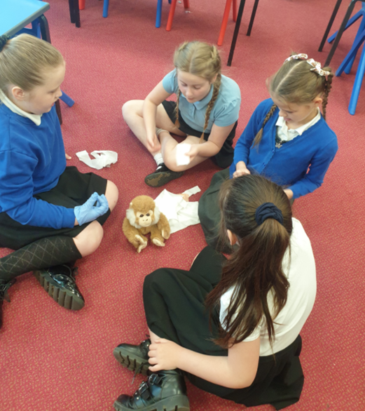 Year 3 children enjoying their English 'Experience Day' through role play as vets.