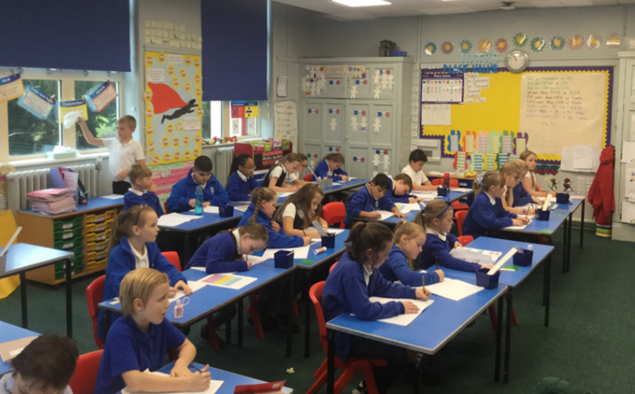 Maths - whole class completing their five quick questions independently.