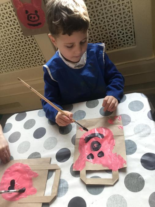 Painting one of the Three Little Pigs