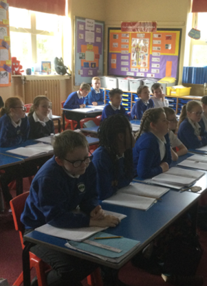 Listening attentively to instructions on how to writ a balanced argument.