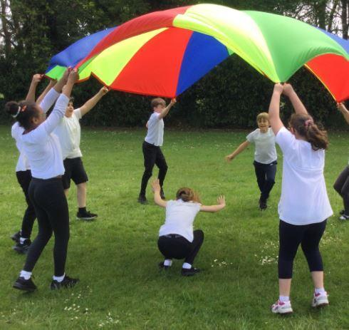 We decided to get the parachute out and have some fun! We were all smiling!