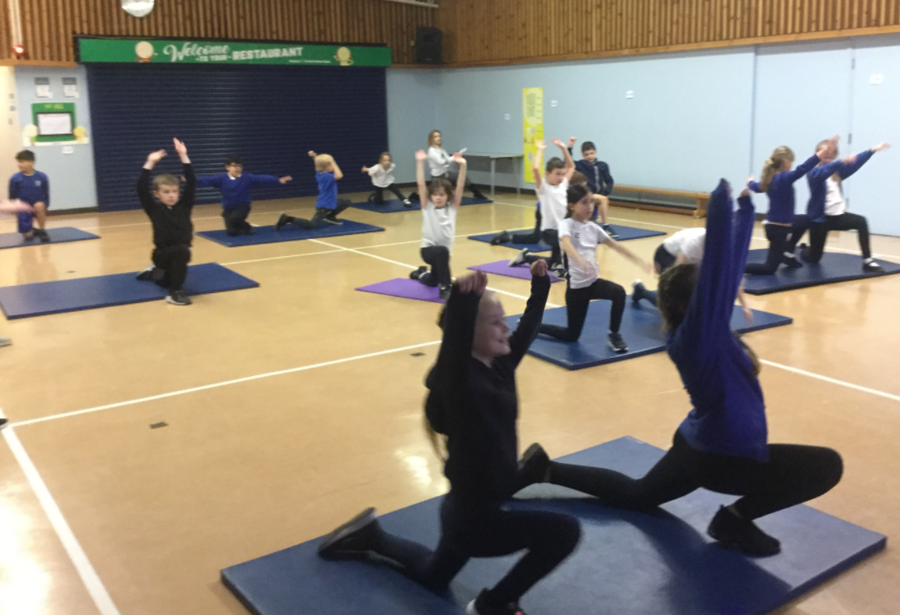 P.E – Year 4/5 stretching their muscles before an intense workout.