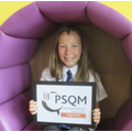 A Year 6 pupil proudly holding their award!