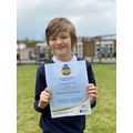 George proudly holding Sunny Bank's certificate