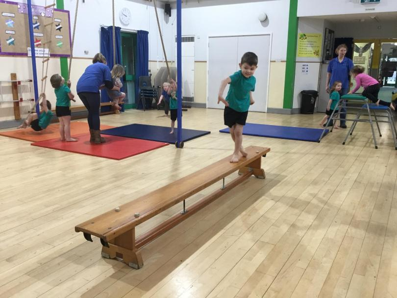 Balancing in one of our PE sessions.