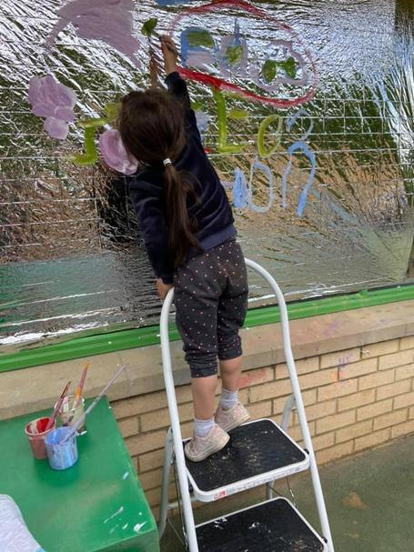 We added an element of risk to our mark making and used the step ladder to mark make.