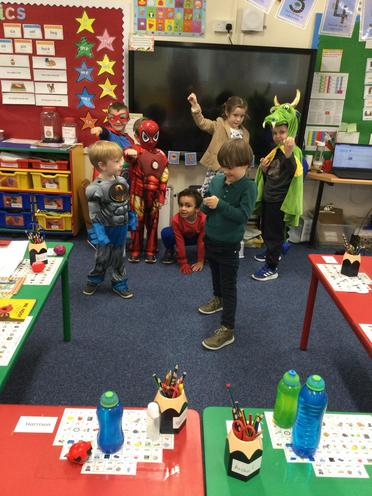 We dressed up as superheroes for comic relief and pulled our best superhero poses!