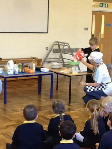 Mrs Davies helping us to make pancakes