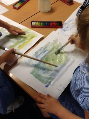 Using water colours to paint the sea