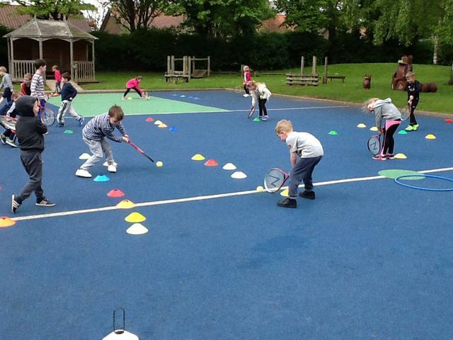 Playing floor tennis