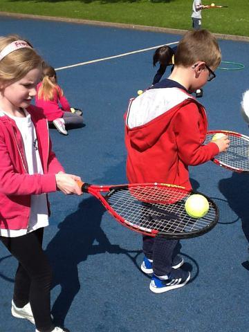 Balancing a ball on a tennis racket