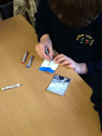 Using pastels to draw part of the picture