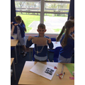 Year 5 investigating forces through parachutes.