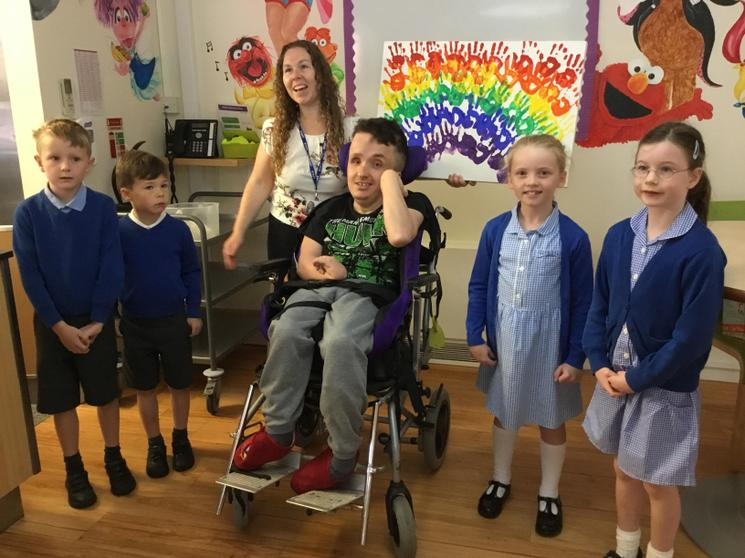 Class One presented an art canvas to Derian House
