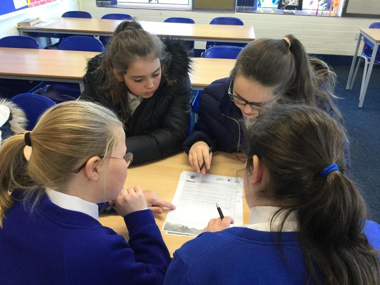 Y6 collaborating and discussing