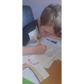 Olly working hard on his writing