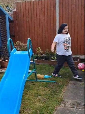 Olivia ran round the garden.