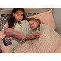 Sharing a book in bed