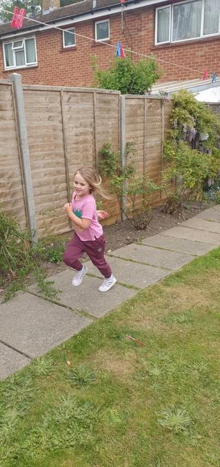 Libby ran round the garden.