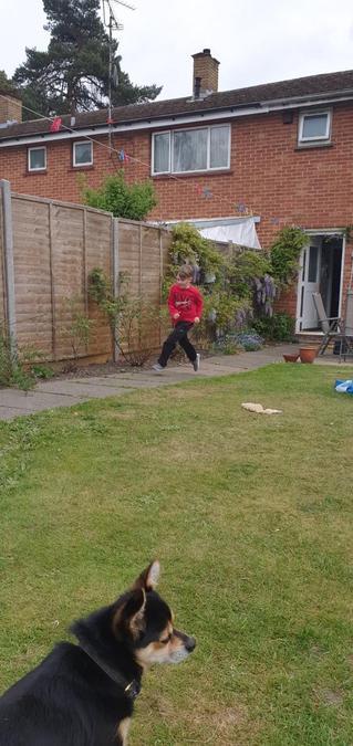 Olly ran round the garden.