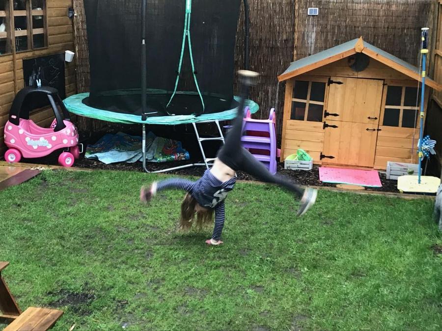 Olivia did cartwheels.
