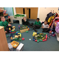 Creating a zoo using foam blocks and animals