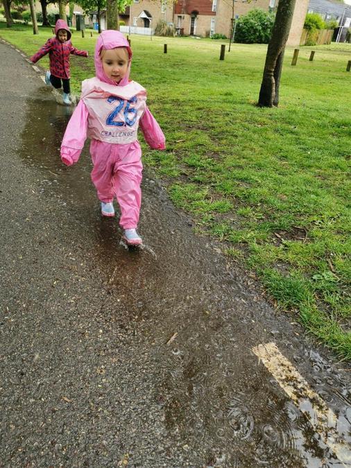 Klara splashed in puddles.