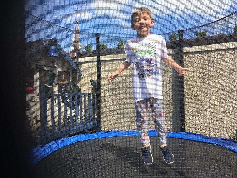 Harry bounced on the trampoline.
