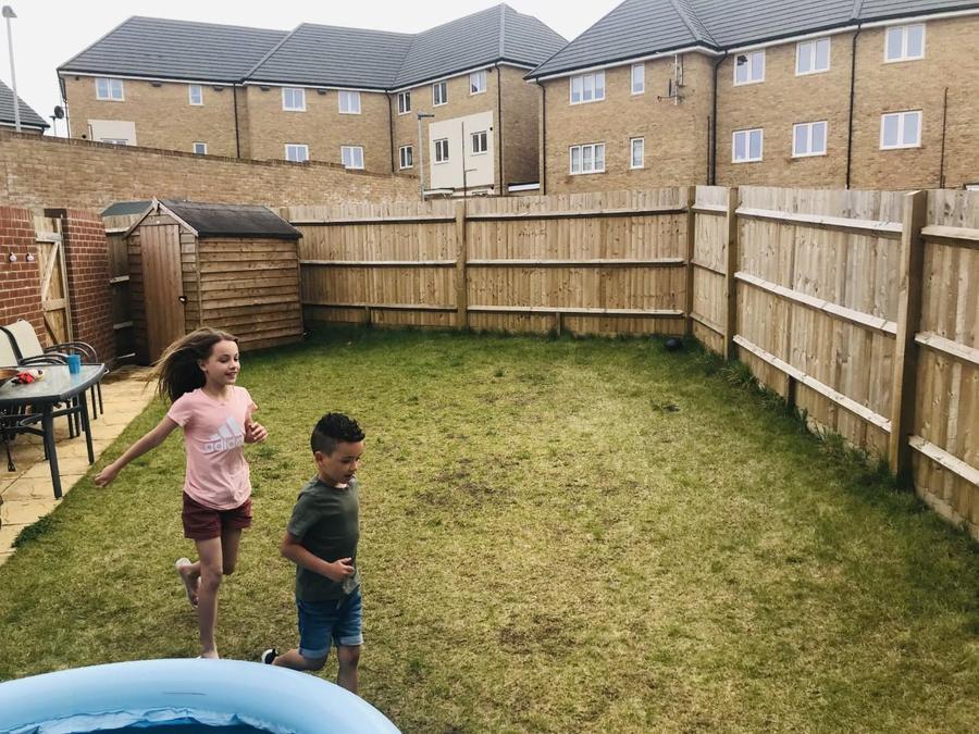 Lacey and Freddie ran round the garden.