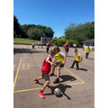 St Clement's pupils play football