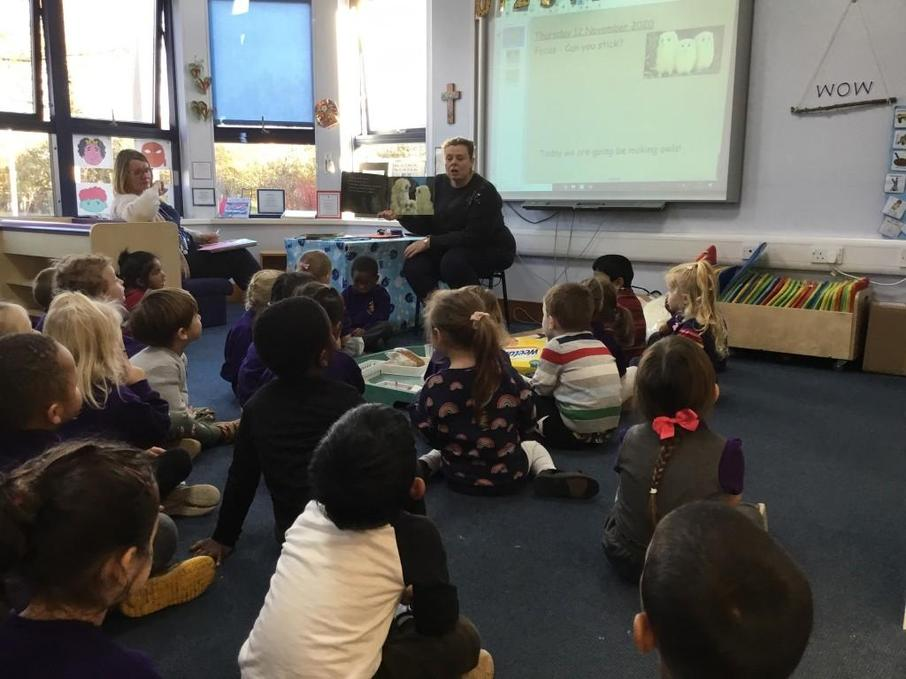 Listening to a story 'Owl Babies' read by teacher