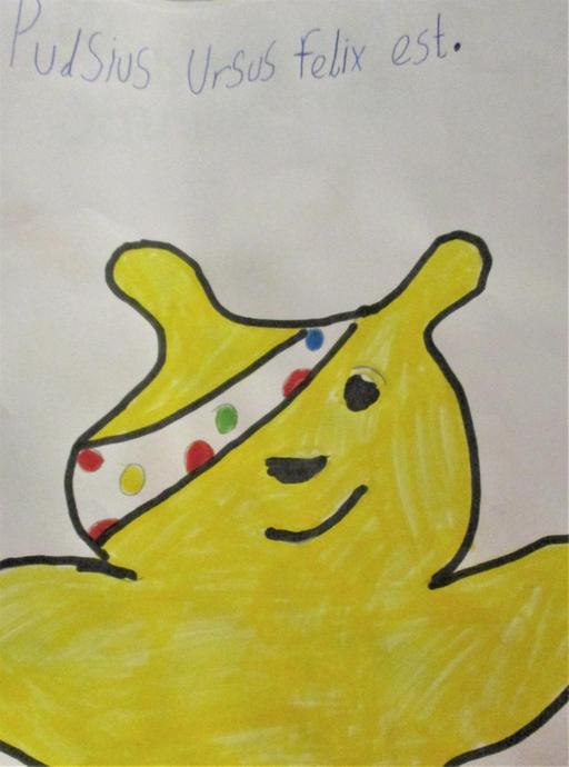 Pudsey bear is happy.