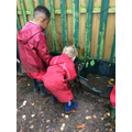 Forest School - playing in the mud kitchen.