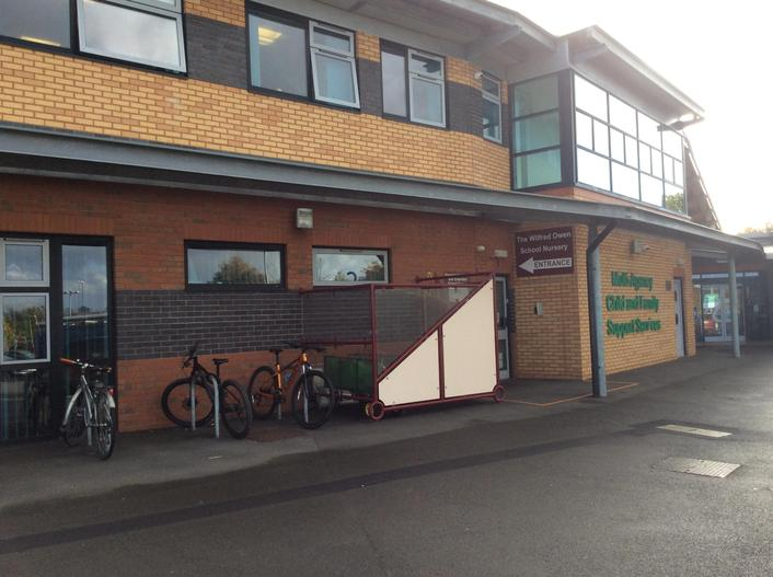 To the right you will see the Reception class entrance (Clee) and the buggy store.