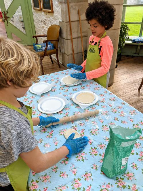 The children get to make pizzas and bake biscuits
