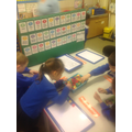 Making a number line using magnetic letters.