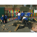 The children building a car from outdoor materials