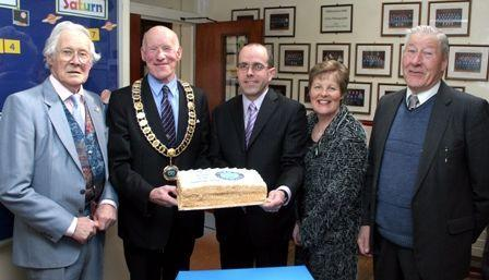 Mr David Dickson receives a celebratory cake from