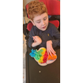 Liam working hard at home with home learning