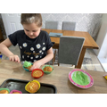 Lilly working hard at home and loves her cake making work.