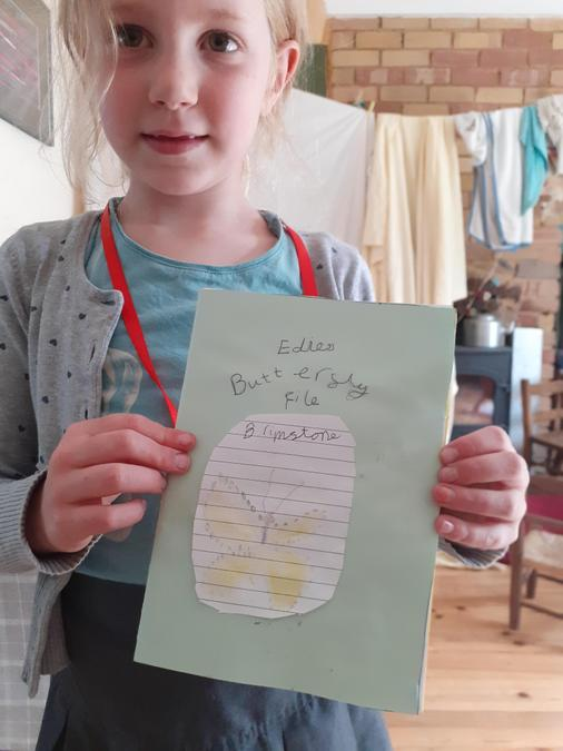 Edie is creating her own butterfly fact file book