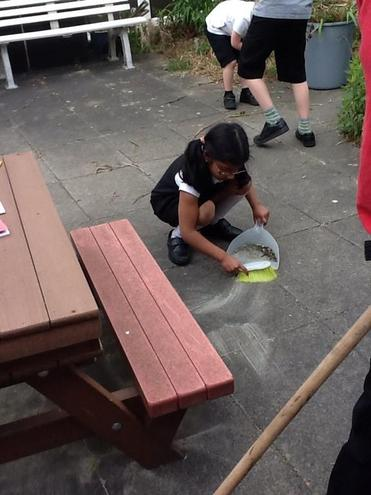 Hard at work sweeping the courtyard!