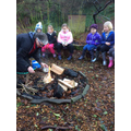 Mrs. Parry shows us how to make a campfire.