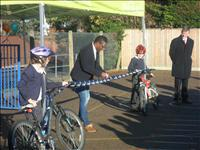 Deano cutting the ribbon for the new bike shelter.