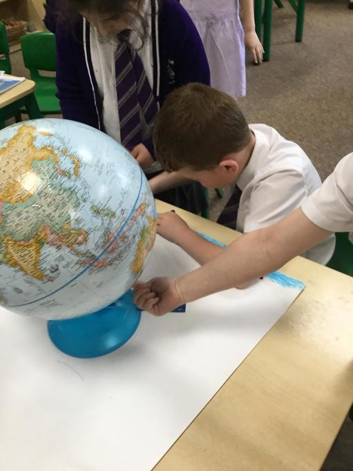 Looking at globes. Discussing animals and habitats.