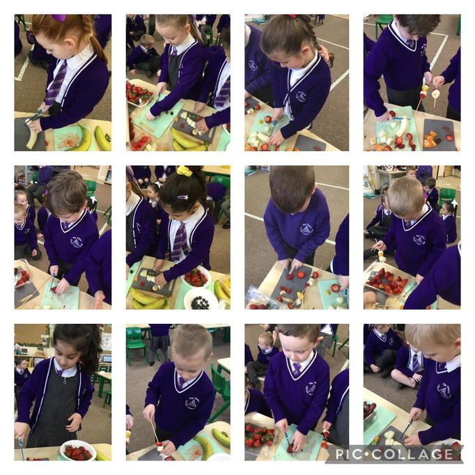 The children practising their skills of using a knife to cut the fruit.
