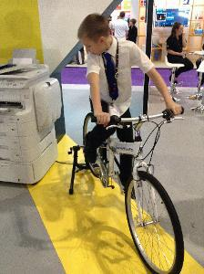 Photo of pupil using a bike to power a photocopier