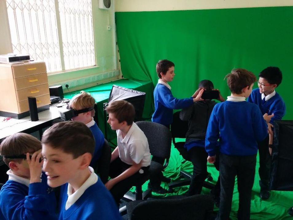 Photo of pupils using green screen