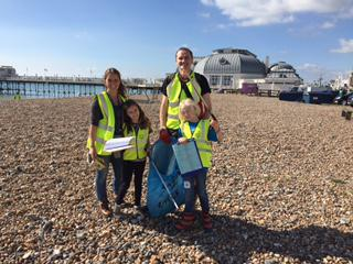 Photo of pupils litter picking on the beach